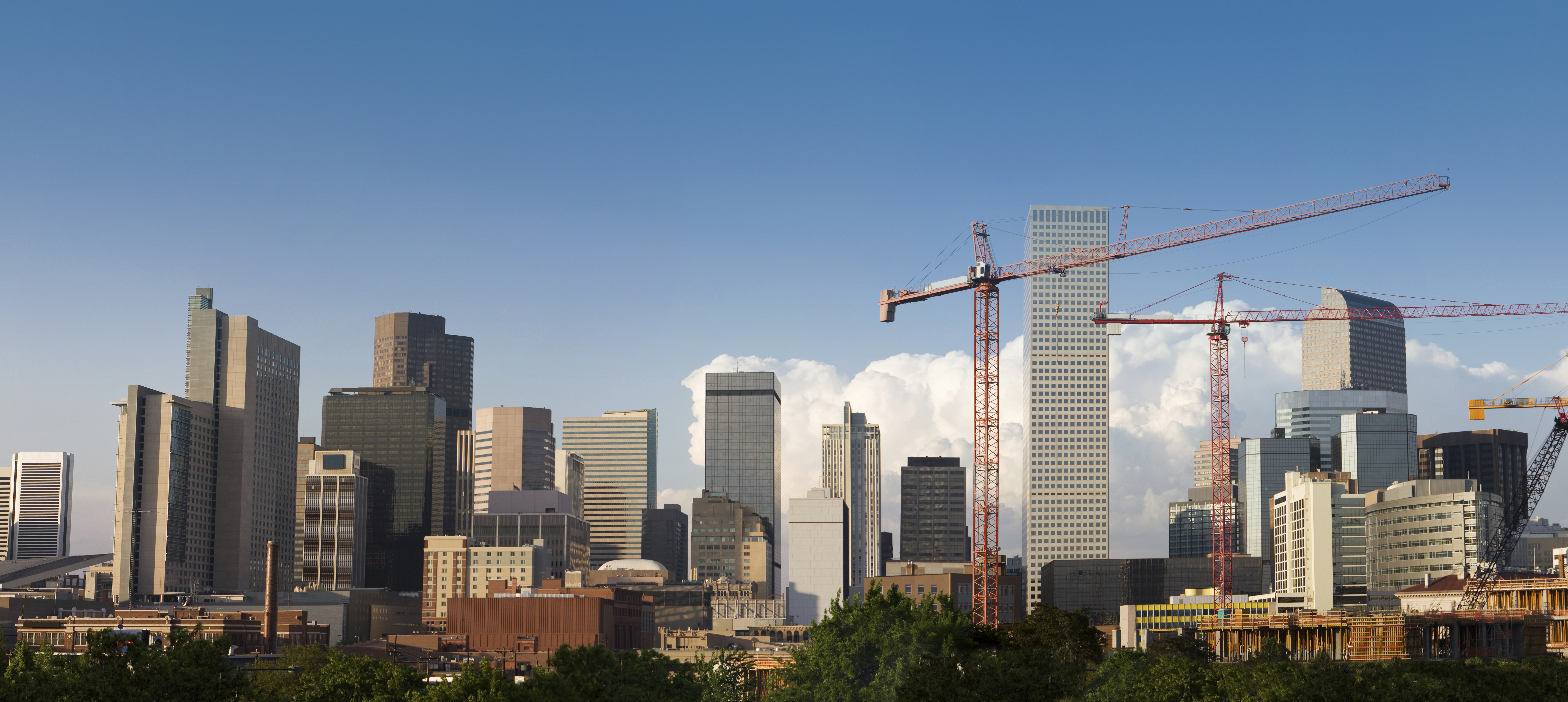 Sharp vertical shots merged into a huge panoramic composition of the skyline of Denver, Colorado.